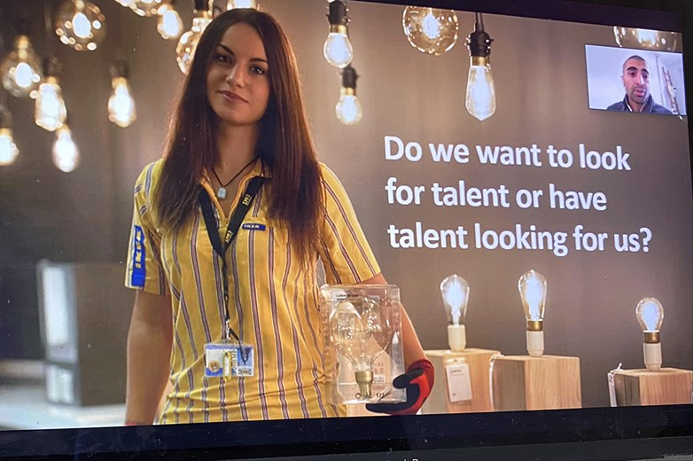 Recruitment picture of a woman smiling in IKEA outfit