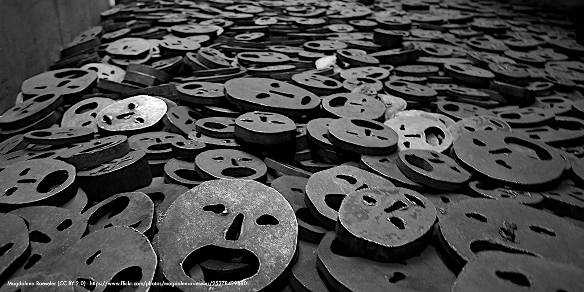 Metal pieces with faces in a pile